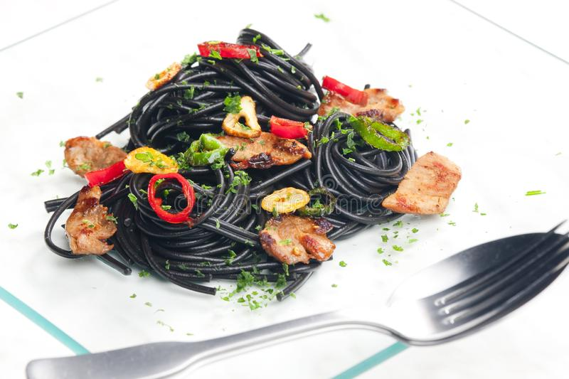 sepia spaghetti with turkey meat and chilli stock photos