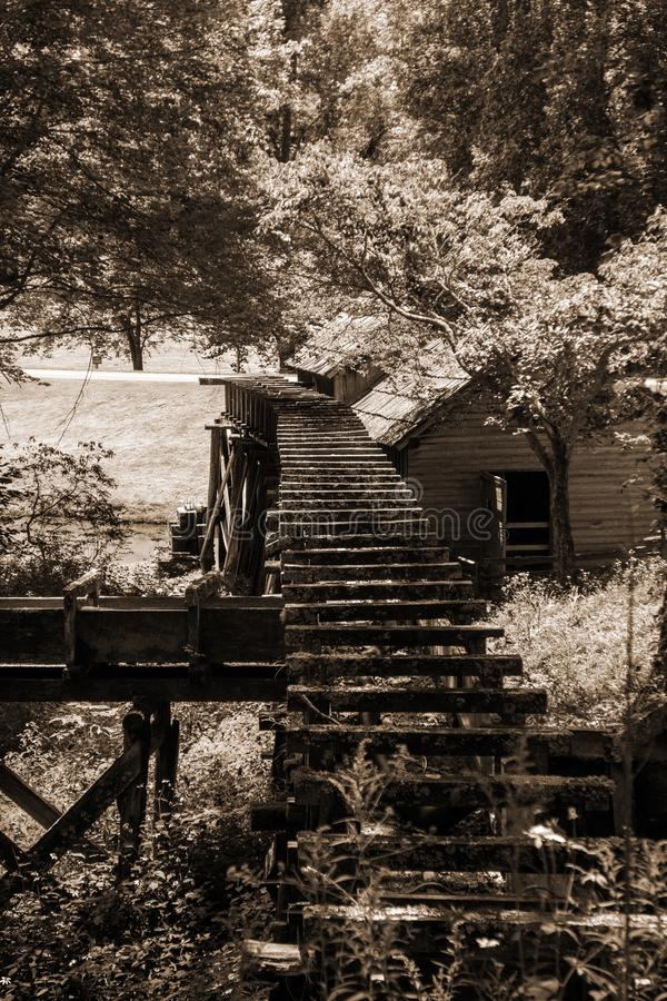 Flume at Mabry Mill, Blue Ridge Parkway, Virginia, USA. A sepia tome image of the flume which channeling the water used to power Mabry Mill located on the Blue stock images