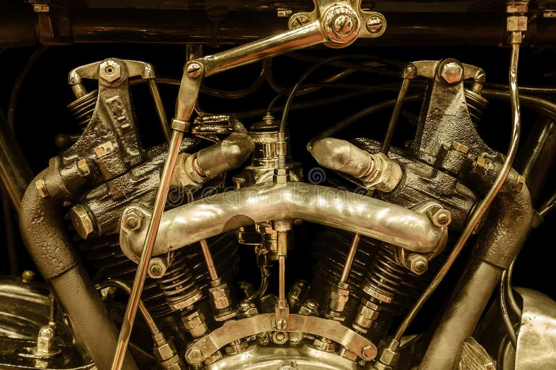 Sepia toned close-up view of a vintage motorcycle engine stock image