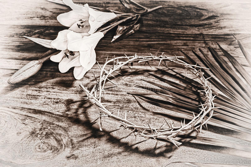 Sepia Toned Easter Icons. A sepia toned black and white image depicting Christian religious icons relating to Easter - the palm branch, the crown of thorns, and stock photo