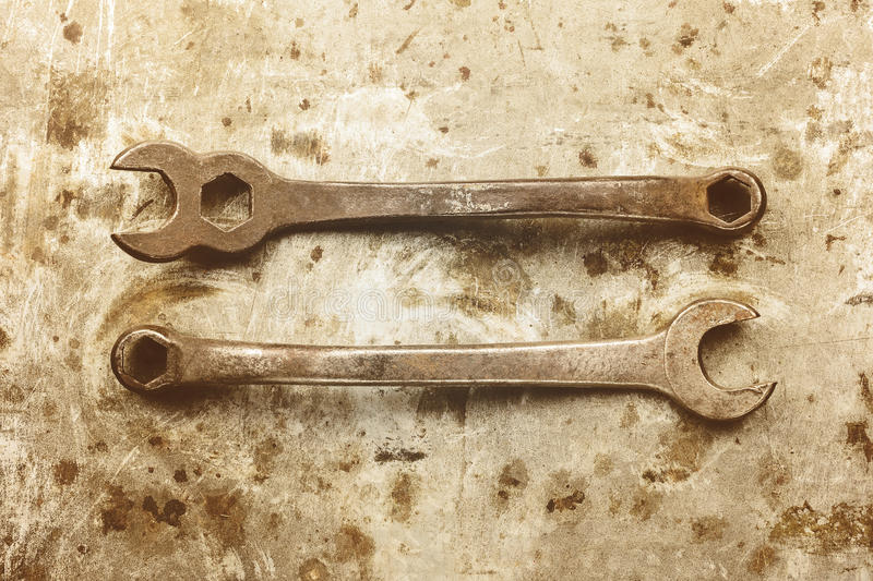 Sepia toned image of old wrenches stock images