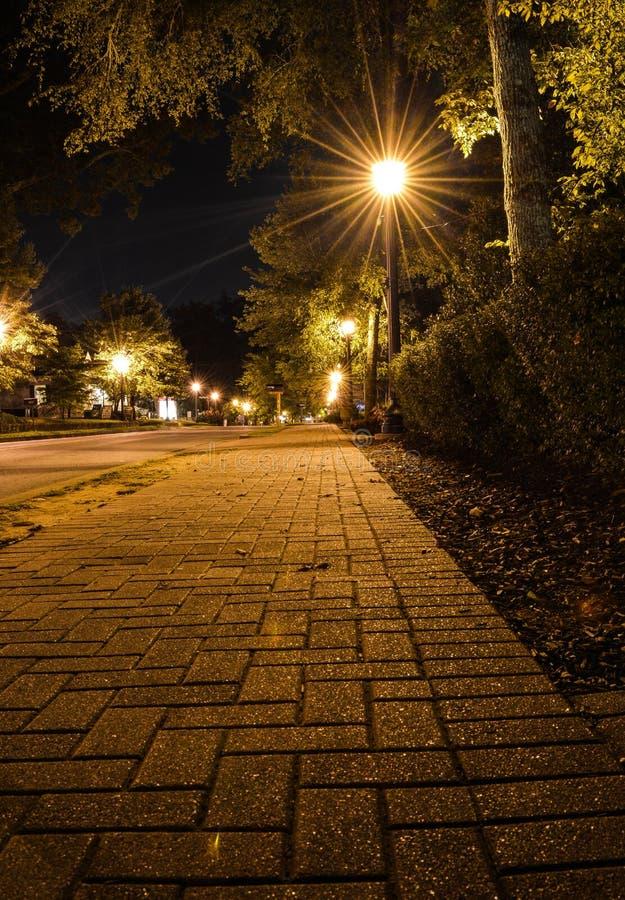 Sepia toned Streetlight Flare. Sepia toned light flare lighting a brick sidewalk in Roswell Georgia stock photo
