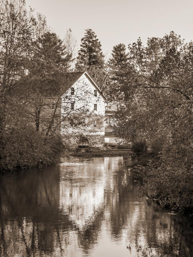 Gristmill Reflection. A sepia toned photograph of the old Gristmill of Historic Walnford in Upper Freehold New Jersey royalty free stock photos