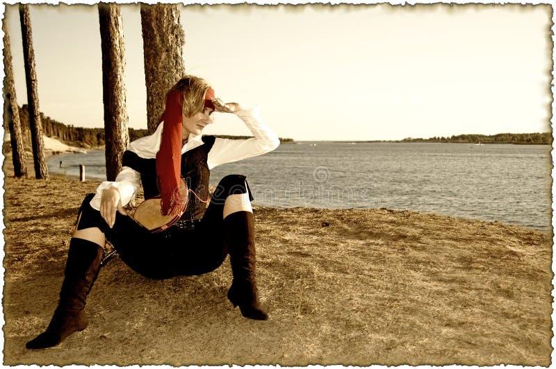 Sepiaabbildung mit gebrannten Rändern (Piratenmädchen serie) stockfotos