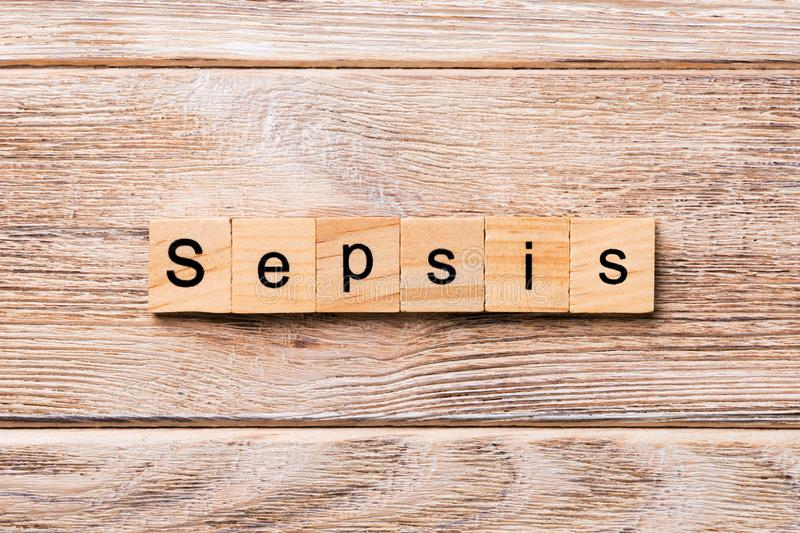 Sepsis word written on wood block. Sepsis text on wooden table for your desing, concept.  stock photo