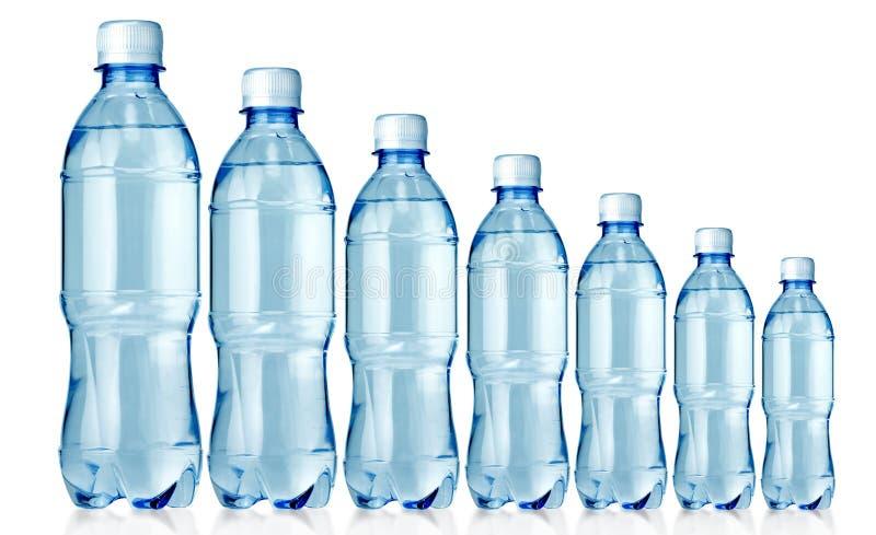Sept bouteilles photographie stock