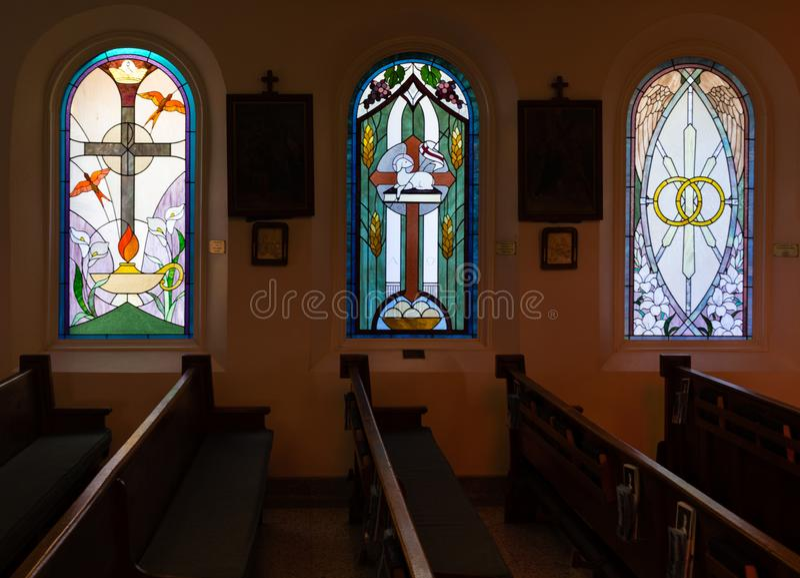 Beautiful stained glass windows grace the interior of the Saint Elizabeth of Hungary Catholic Church in Eureka Springs, Arkansas. Sept. 2018 - Eureka Springs royalty free stock photo