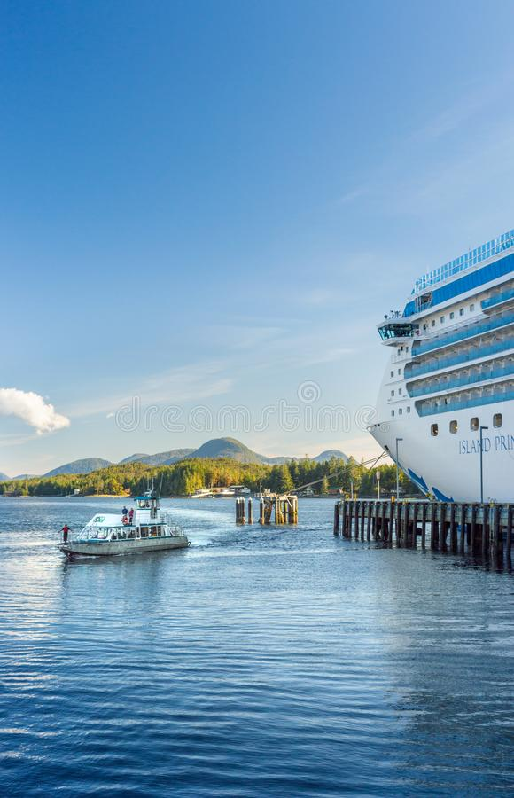 Sept. 17, 2018 - Ketchikan, AK: Sea Otter Express returing to port alongside Island Princess cruise ship. stock photos