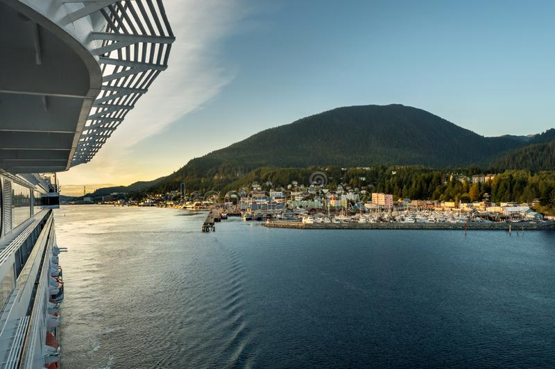 Sept. 17, 2018 - Ketchikan, AK: View of city from upper deck of cruise ship as it leaves port in late afternoon sunlight stock photography