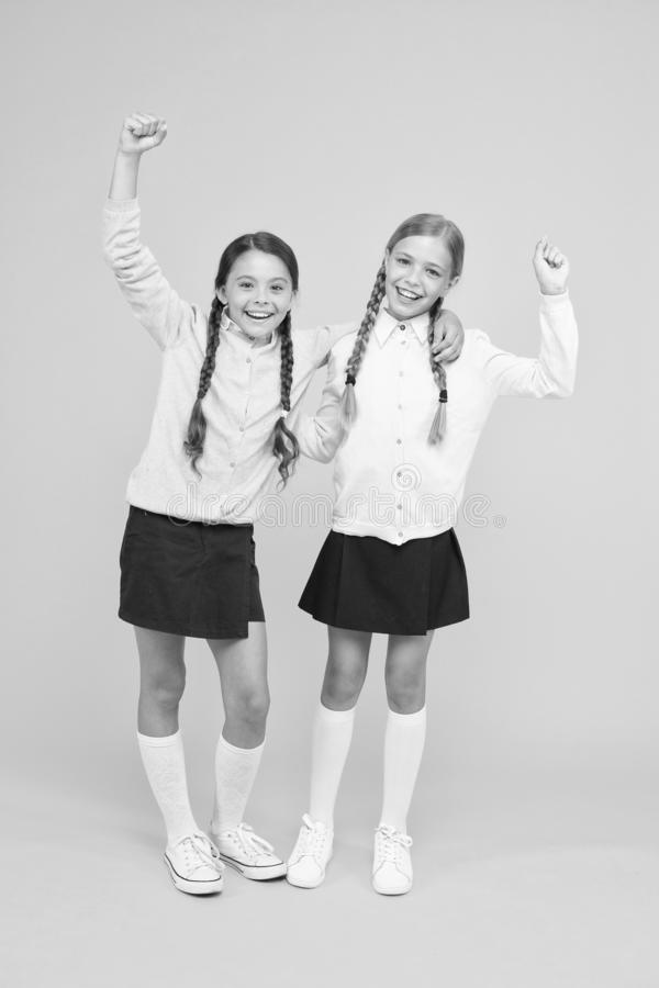 September again. Childhood happiness. School day fun cheerful moments. Kids cute students. Schoolgirls best friends stock image
