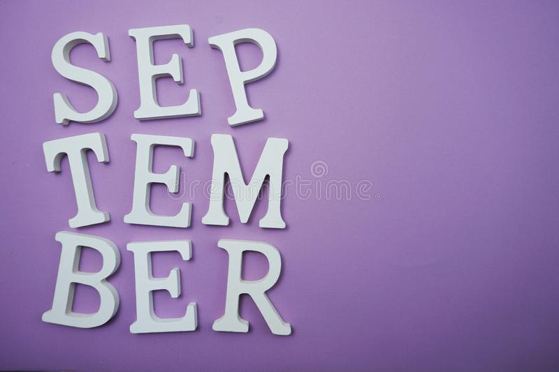 September alphabet letter with space copy on Purple background. Top view of September alphabet letter with space copy on Purple background royalty free stock photo