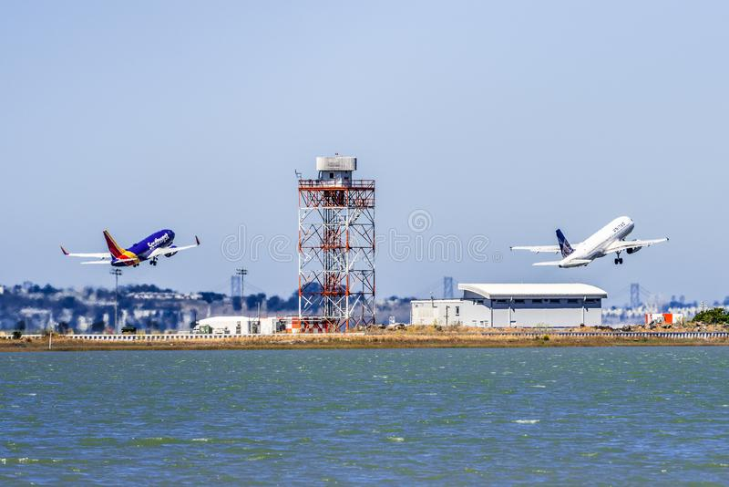 September 1, 2019 Burlingame / CA / USA - Two air crafts Southwest Airlines and United Airlines taking off at the same time from. San Francisco International stock image