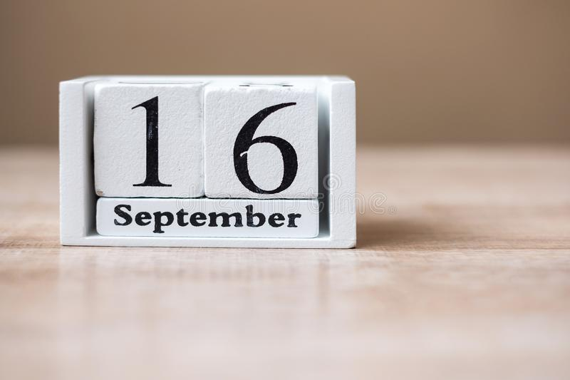 16 September of calendar wooden Mexico Independence Day, World Ozone day and Happy Malaysia day concept.  royalty free stock photo