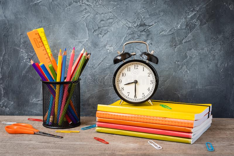 1 September concept postcard, teachers` day, back to school or college, supplies, alarm clock royalty free stock photo