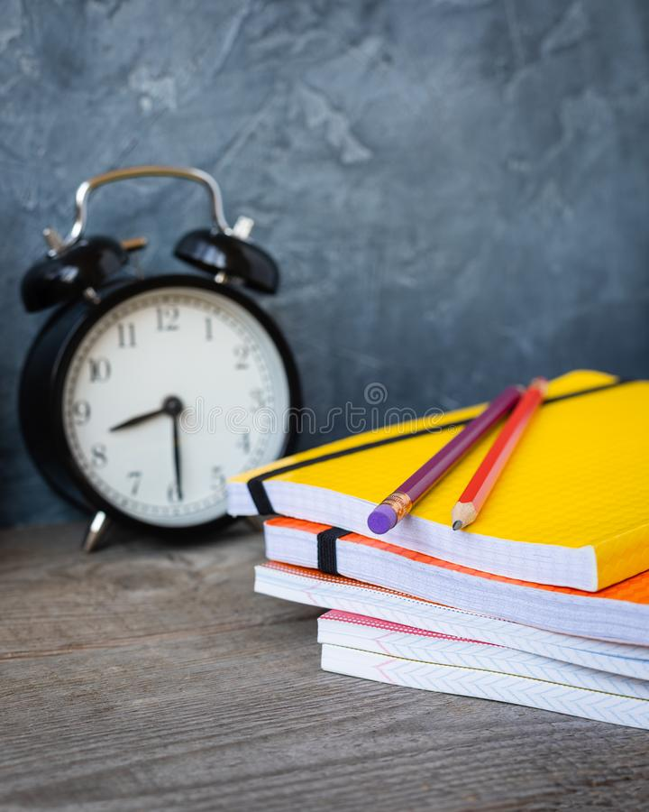 1 September concept postcard, teachers day, back to school or college, supplies, alarm clock. 1 September concept postcard, teachers day, back to school royalty free stock images