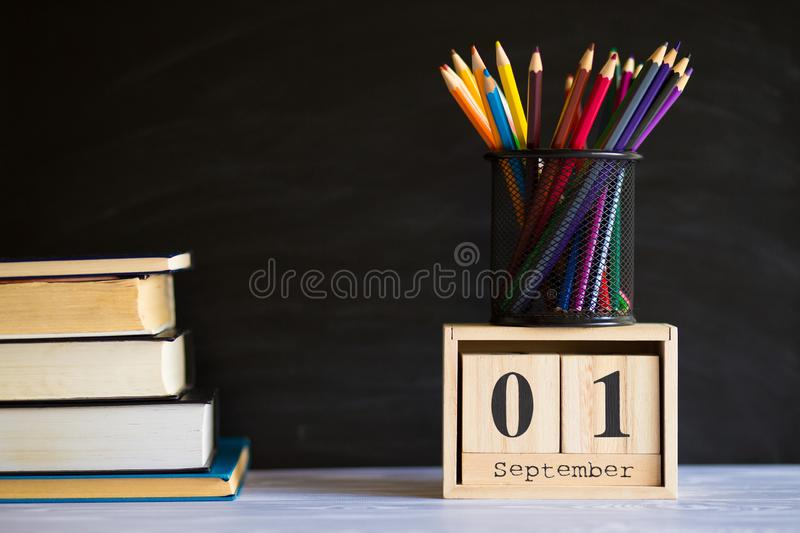 1 September concept postcard, teachers day, back to school, supplies. Calendar set on 1st september stock images