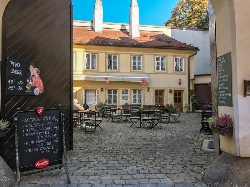 Kavarna Cas, cafe courtyard, Prague, Czechoslovakia. September 2017: Courtyard with tables and chairs, Kavarna Cas, cafe and tavern, Prague, Czechoslovakia royalty free stock photo