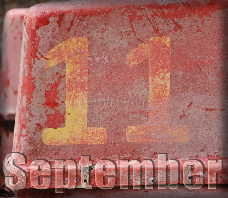 11 September. The figure eleven on a red shabby background. the inscription September royalty free illustration