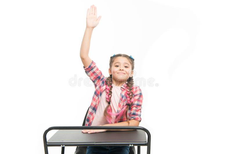 September 1 the first day of school year. Little girl raising hand on September 1 isolated on white. Small pupil having stock images