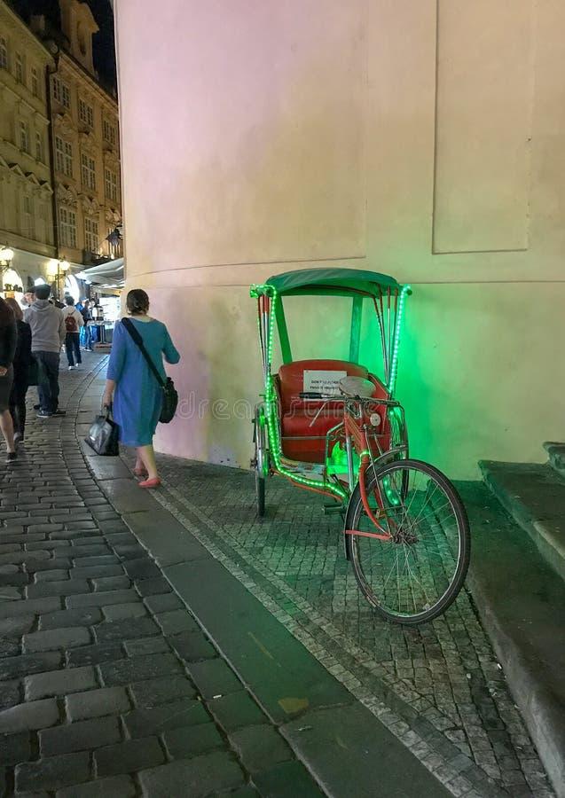 Green lights glow on tourist bicycle, Prague Old Town royalty free stock photos
