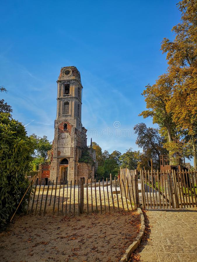 September 2018 - Hainaut, Belgium: The remains of the old church tower of the Abbey of Cambron, now the bird tower of the zoo royalty free stock photos