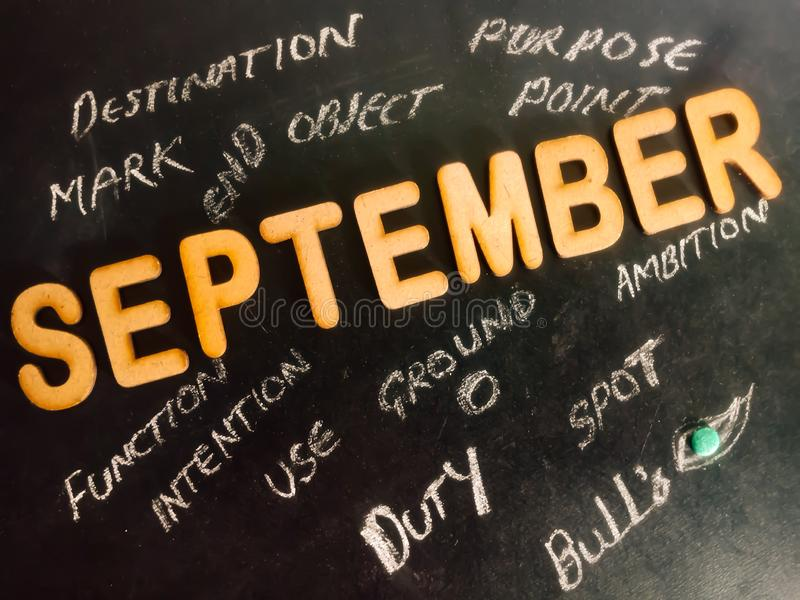 september month objects concept displaying with chalkboard stock image