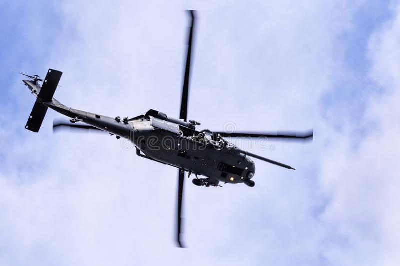 September 7, 2019 Mountain View / CA / USA -  Military helicopter performing search and rescue training exercises around Moffett royalty free stock photography