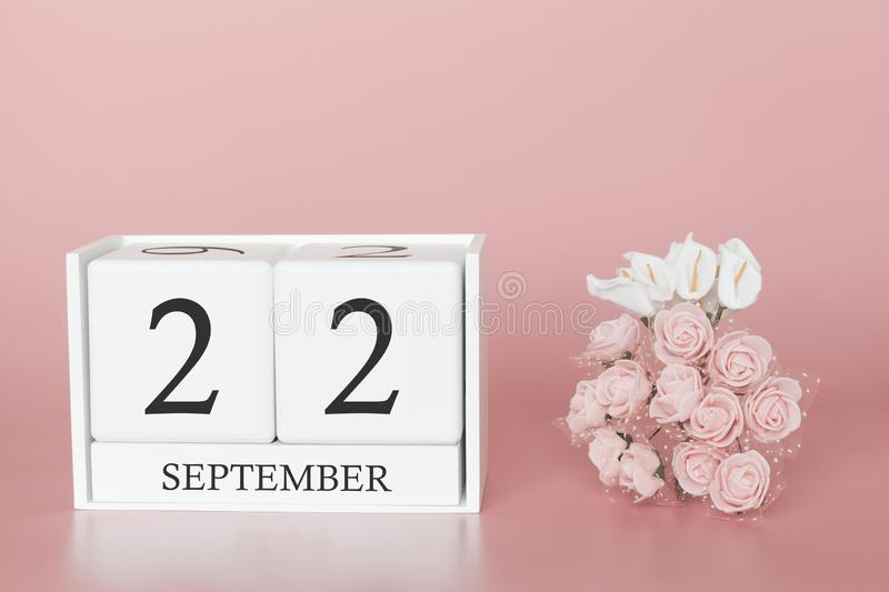September 22nd. Day 22 of month. Calendar cube on modern pink background, concept of bussines and an importent event royalty free stock photography