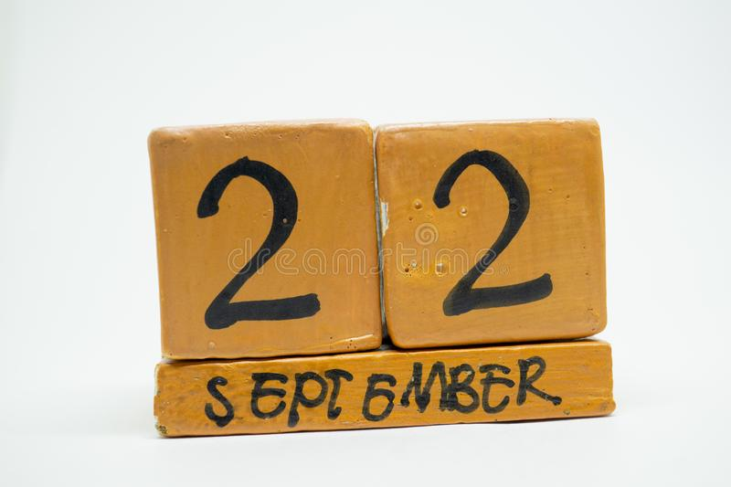 september 22nd. Day 22 of month, handmade wood calendar isolated on white background. autumn month, day of the year concept stock photos