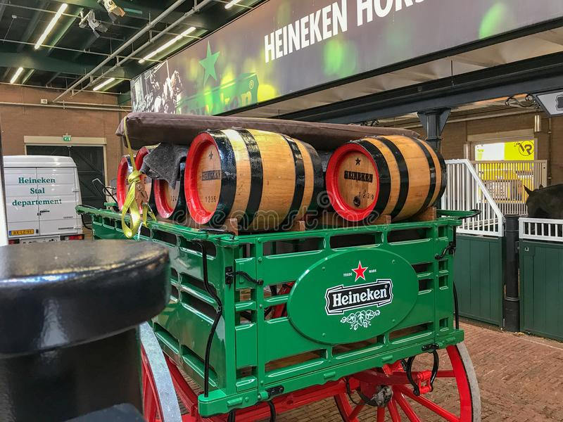 Old Heineken wagon carrying beer kegs on display in Heineken brewery, Amsterdam. September 2017: Old Heineken wagon with beer kegs in the Heineken brewery royalty free stock image