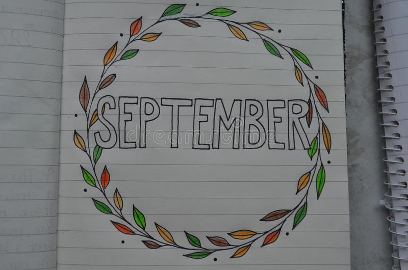 September op een pagina van een notitieboekje wordt geschreven dat stock foto