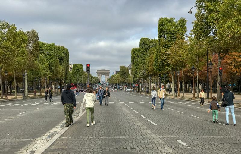 Strollers on the Champs Elysees during a car-free Sunday, Paris, France royalty free stock images
