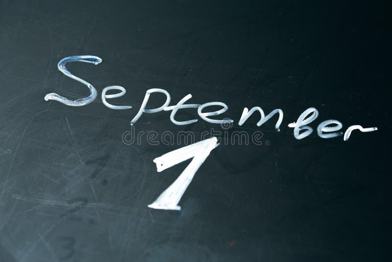 September 1 The phrase written in chalk on the blackboard. royalty free stock images
