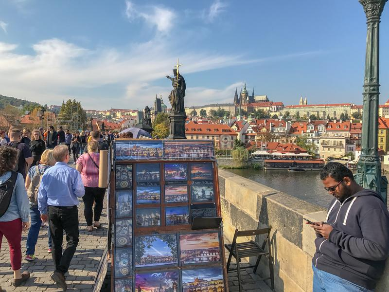 Postcard vendor on the Charles Bridge, Prague, Czechoslovakia. September 2017: Postcard vendor on the Charlies Bridge in Prague, Czechoslovakia royalty free stock photography