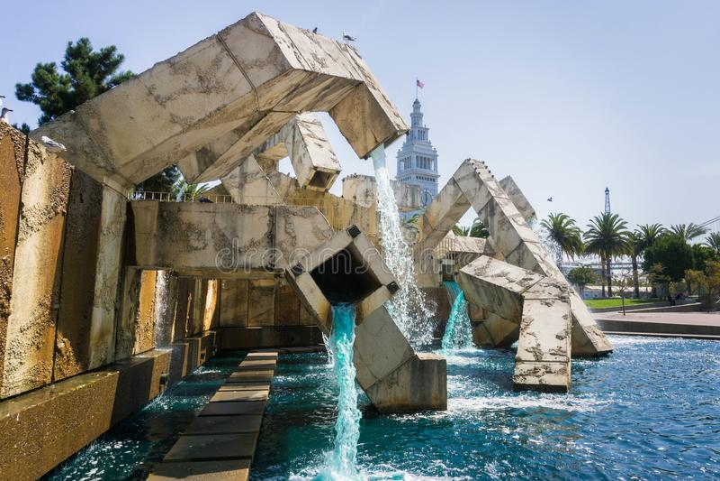 Blue tinted water running through Vaillancourt Fountain in Justin Herman Plaza , San Francisco royalty free stock photo