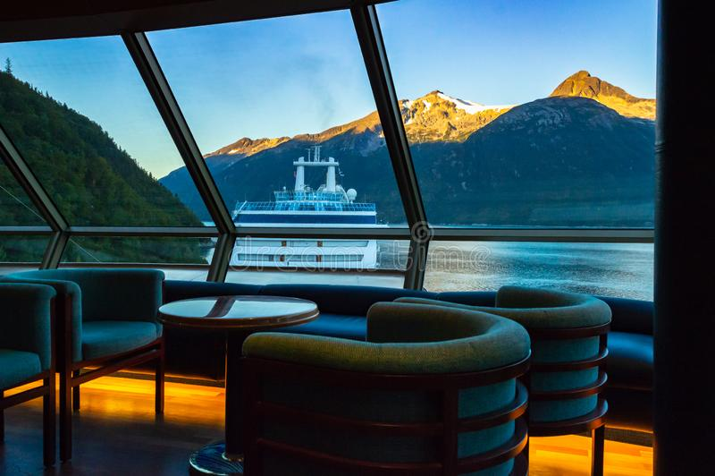 September 15, 2018 - Skagway, AK: Sunrise view of ship in port from inside The Crow`s Nest aboard The Volendam. September 15, 2018 - Skagway, AK: Sunrise on royalty free stock images