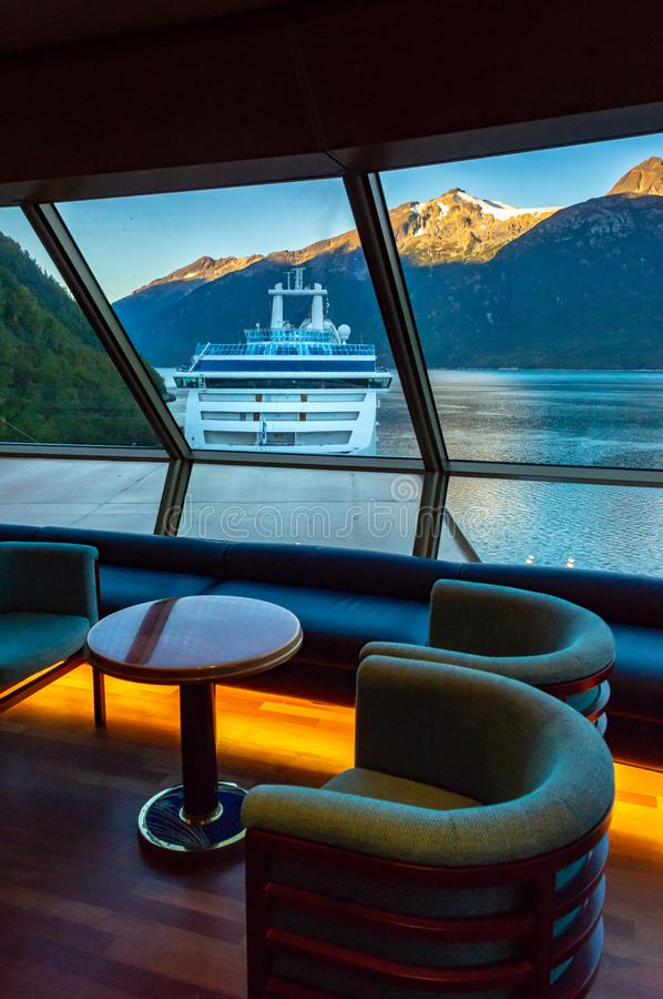 September 15, 2018 - Skagway, AK: Sunrise view of ship in port from inside The Crow`s Nest aboard The Volendam. September 15, 2018 - Skagway, AK: Sunrise on royalty free stock photos