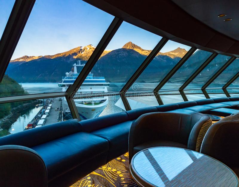 September 15, 2018 - Skagway, AK: Sunrise view of ship in port from inside The Crow`s Nest aboard The Volendam. September 15, 2018 - Skagway, AK: Sunrise on stock photo