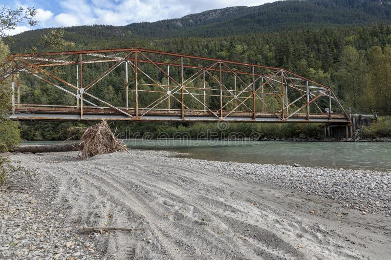 Old bridge over the Dyea river near the Klondike gold rush historical Park near Skagway Alask royalty free stock images