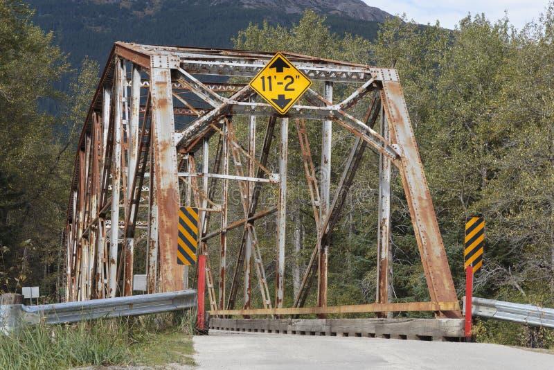 Old bridge over the Dyea river near the Klondike gold rush historical Park near Skagway Alask. September 12 2018, Skagway Alaska. Old bridge over the Dyea river stock photos