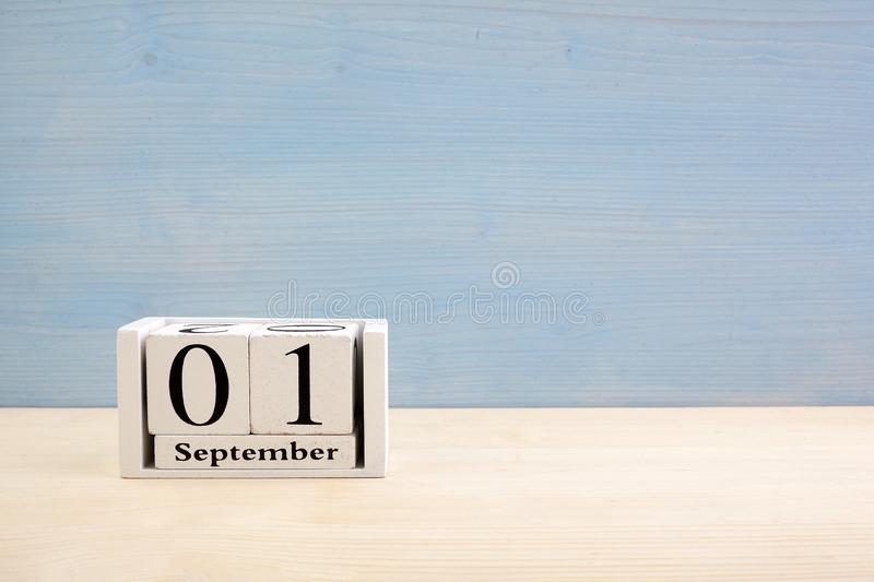 .September 1st white wooden calendar on blue wood background. Copyspace for text. Autumn day. September 1st white wooden calendar on wood background. Copyspace royalty free stock image