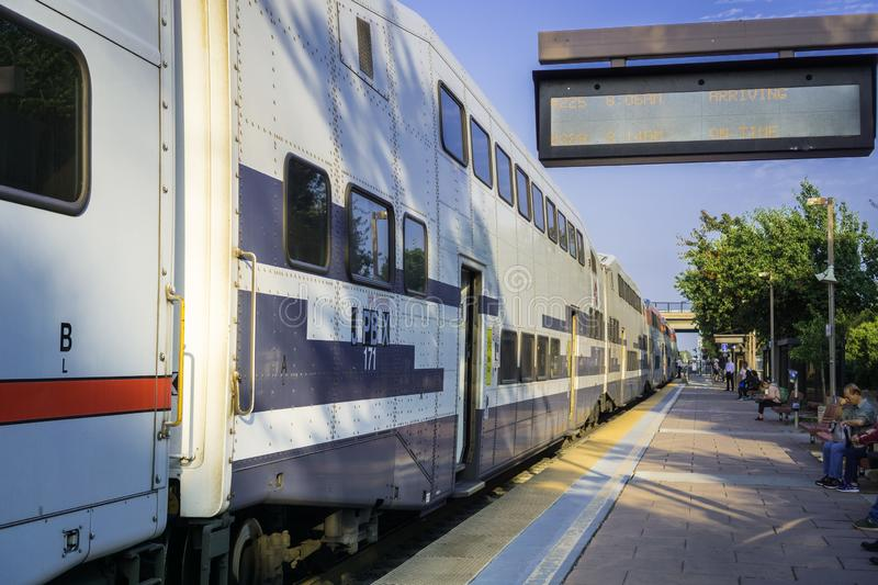 September 5, 2017 Sunnyvale/CA/USA - Local train about to depart the train station in south San Francisco bay stock photo