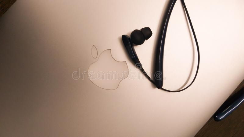 September 18th, 2019 at Chandigarh India: i phone 11 pro release related concept of macbook with samsung level u headphones stock photography
