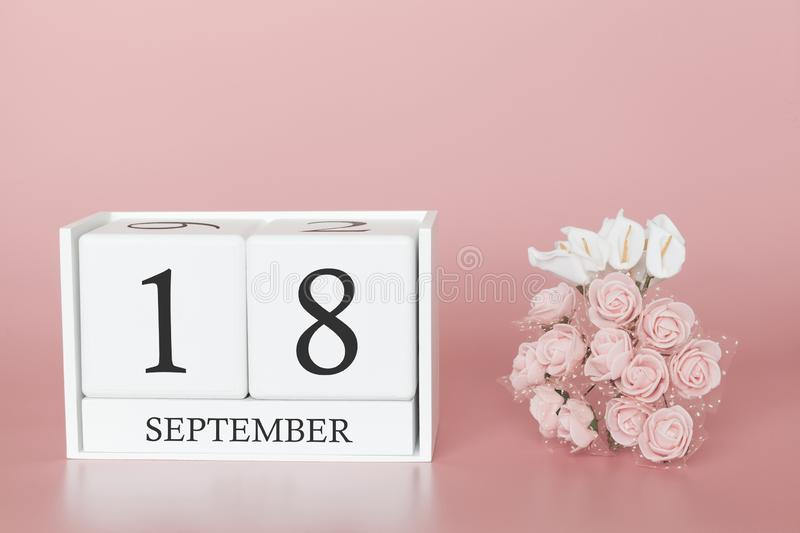 September 18th. Day 18 of month. Calendar cube on modern pink background, concept of bussines and an importent event royalty free stock image