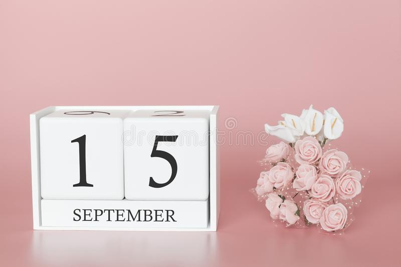 September 15th. Day 15 of month. Calendar cube on modern pink background, concept of bussines and an importent event royalty free stock photo