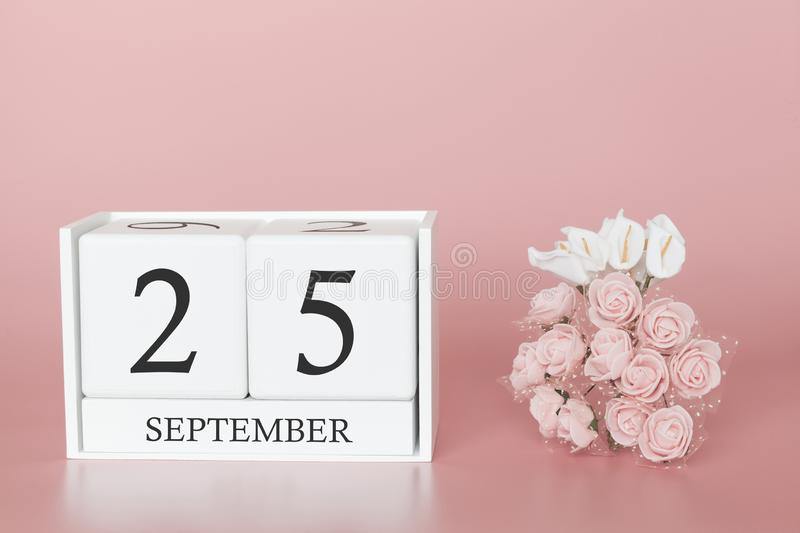 September 25th. Day 25 of month. Calendar cube on modern pink background, concept of bussines and an importent event stock photos
