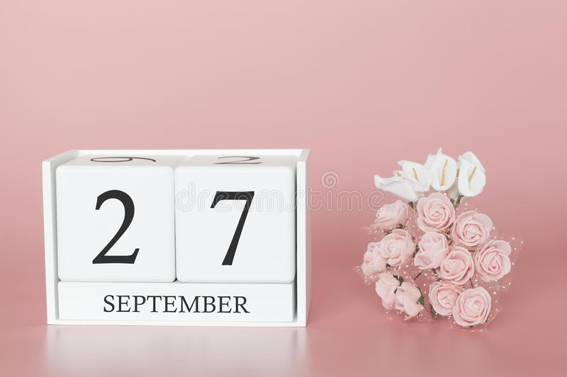 September 27th. Day 27 of month. Calendar cube on modern pink background, concept of bussines and an importent event royalty free stock photo