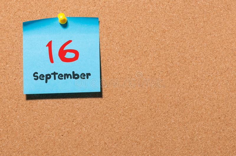 September 16th. Day 16 of month, color sticker calendar on notice board. Autumn time. Empty space for text royalty free stock image
