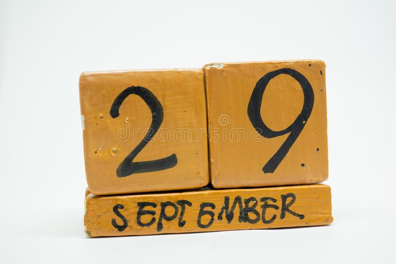 september 29th. Day 29 of month, handmade wood calendar isolated on white background. autumn month, day of the year concept stock photo