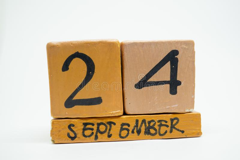 september 24th. Day 24 of month, handmade wood calendar isolated on white background. autumn month, day of the year concept royalty free stock images